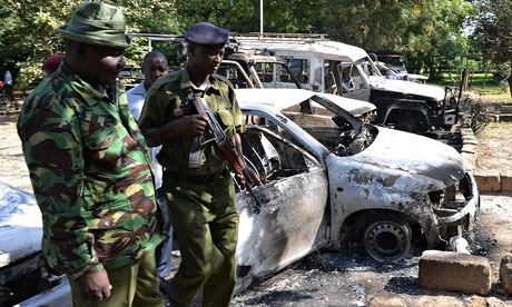 Kenyan police in Mpeketoni after an attack on the town left 50 people dead.