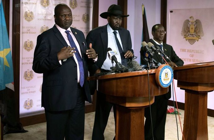 South Sudan President Salva Kiir (C), with VP Riek Machar (L), addresses a news conference at the Presidential State House in Juba, South Sudan, July 8, 2016.