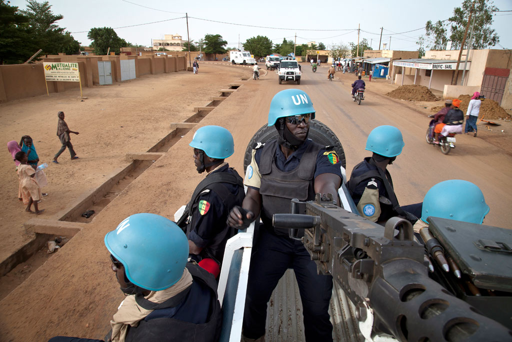 Senegalese police officers serving with the UN Multidimensional Integrated Stabilization Mission in Mali (MINUSMA), patrol the streets of the city of Gao.