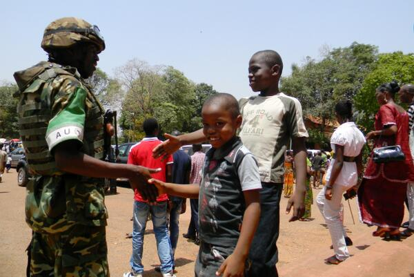 Bangui children interact with MISCA Peacekeeper; copyright African Union