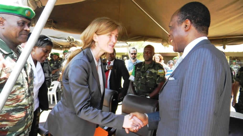 The Special Representative of the Chairperson of the African Union (AU) Commission and Head of the African-led International Support Mission in the Central African Republic (MISCA), Gen. Jean Marie Michel Mokoko shaking hand with  US Permanent Representative to the United Nations (UN), Ambassador Samantha Power during the ceremony to hand over 37 vehicles donated by the USA to MISCA.