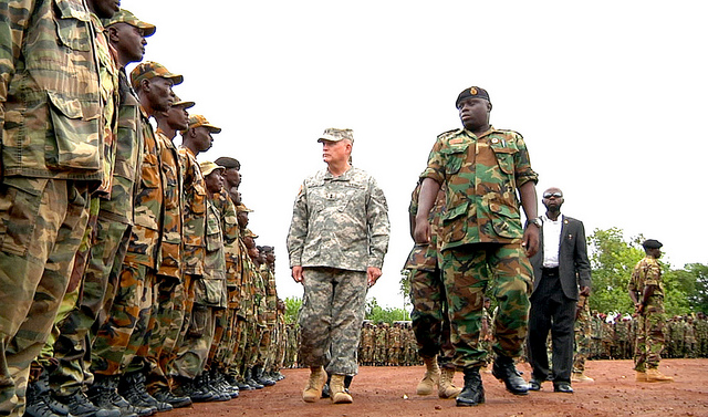 Maj. Gen. David R. Hogg (center), commander U.S. Army Africa and Lt. Col. A.B. Conteh, AMISOM Battalion Commander, RSLAF, inspect Sierra Leone troops during a deployment ceremony May 20. Nearly 1,000 Republic of Sierra Leone Armed Forces personnel completed training for an upcoming African Union Mission in Somalia (AMISOM) deployment. (U.S. Army Africa photo)