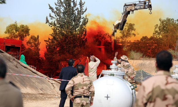 Experts in Tripoli monitor a November 2012 operation to dispose of Libyan chemical weapons. Photograph: Mahmud Turkia/AFP/Getty Images