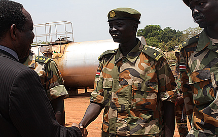 Special Envoy of the Chairperson of the AU Commission for the LRA issue, Ambassador Francisco Madeira shakes hands with the Sudan People's Liberation Army (SPLA), in Yambio town, capital of the Western Equatorial State (WES), South Sudan, 25 September 2012
