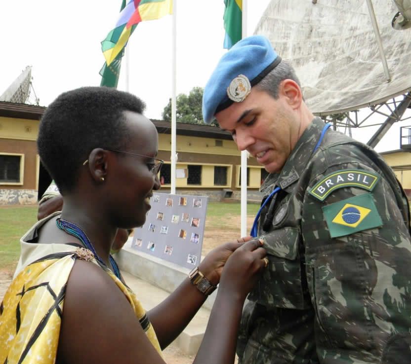 #MISCA's Lt. Lausane Nsengimana welcomes guests to #Rwanda20yrs memorial service in #Bangui