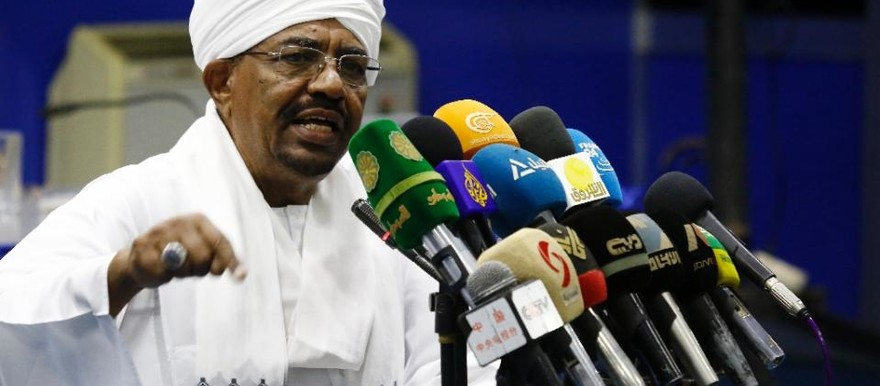 President Omar Al Bashir addresses top officials of his ruling National Congress Party during a meeting